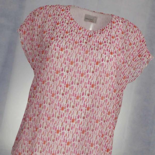 Zweilagige Bluse, die obere Lage ist aus einem leichten Stoff mit Kämmchen und Bürsten.